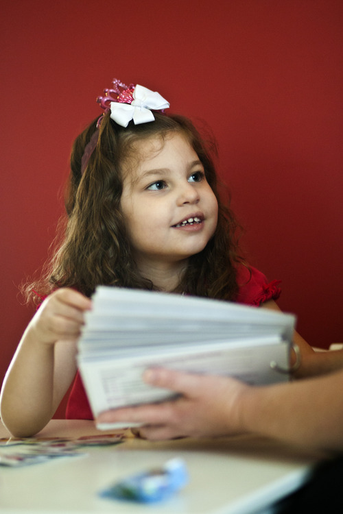 "Chris Detrick  |  The Salt Lake Tribune Lucy Vasquez looks to her mother, Angela Vasquez, for confirmation that she picked the right image for ""ice cream."" Angela uses flash cards to help her 4-year-old autistic daughter, learn to communicate."