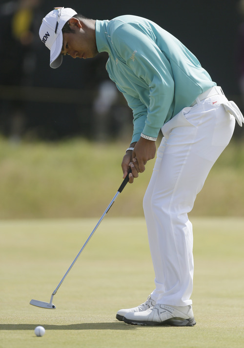 Hideki Matsuyama of Japan putts on the first green during the final round of the British Open Golf Championship at Muirfield, Scotland, Sunday July 21, 2013. (AP Photo/Scott Heppell)