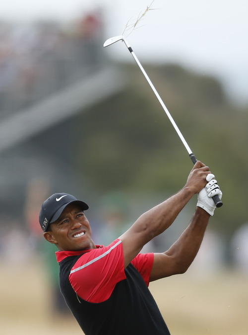 Tiger Woods of the United States plays a shot on the third fairway during the final round of the British Open Golf Championship at Muirfield, Scotland, Sunday July 21, 2013. (AP Photo/Matt Dunham)