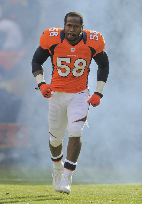 FILE - In this Dec. 30, 2012 file photo, Denver Broncos outside linebacker Von Miller runs onto the field prior to an NFL game against the Kansas City Chiefs  in Denver. A person with knowledge of the situation says Pro Bowl linebacker Von Miller will miss the first month of the season for violating the NFL's drug policy, pending an appeal. The person spoke to The Associated Press on condition of anonymity because the league hasn't announced any punishment. (AP Photo/Jack Dempsey, File)