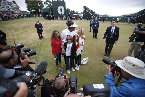 Phil Mickelson of the United States poses with his family after winning the British Open Golf Championship at Muirfield, Scotland, Sunday July 21, 2013.   (AP Photo/Matt Dunham)