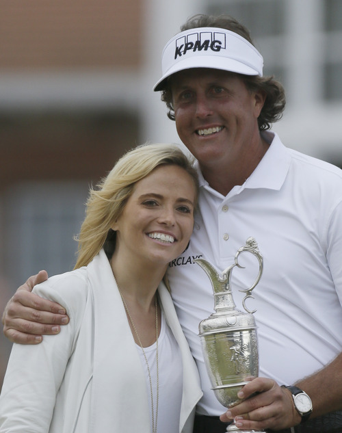 Phil Mickelson of the United States poses with his wife Amy after winning the British Open Golf Championship at Muirfield, Scotland, Sunday July 21, 2013.  (AP Photo/Jon Super)