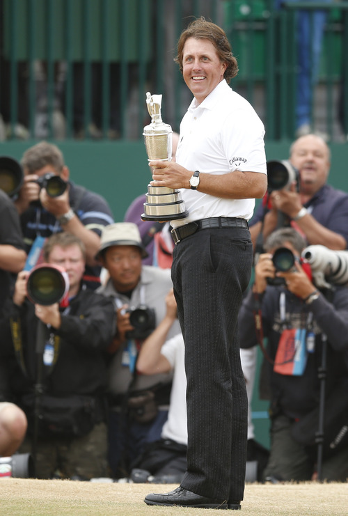 Phil Mickelson of the United States holds the Claret Jug trophy after winning the British Open Golf Championship at Muirfield, Scotland, Sunday July 21, 2013.(AP Photo/Matt Dunham)