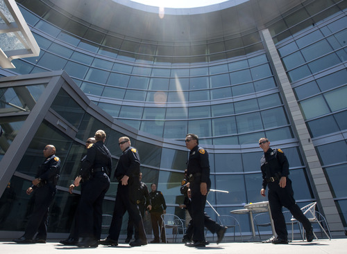 Steve Griffin | The Salt Lake Tribune  Salt Lake City police officers enter the new Public Safety Building after a ribbon-cutting ceremony Friday July 19, 2013.