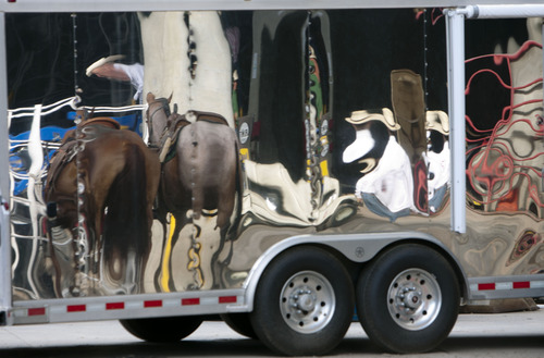 Steve Griffin | The Salt Lake Tribune   Horses and cowboys are reflected in a trailer prior to the start of the Days of '47 Rodeo at EnergySolutions Arena in Salt Lake City, Utah Tuesday July 23, 2013.