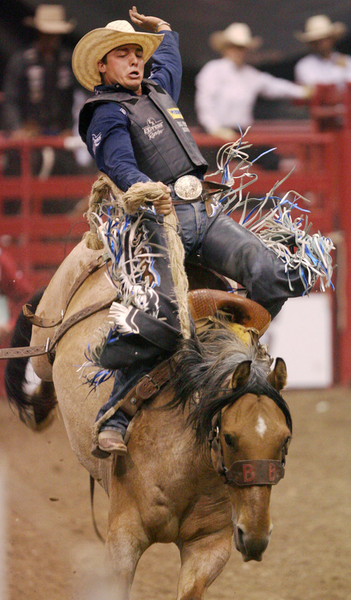 Steve Griffin | The Salt Lake Tribune   Jesse Wright, of Milford, Utah, hangs on during the saddle bronc riding event at the Days of '47 Rodeo at EnergySolutions Arena in Salt Lake City, Utah Tuesday July 23, 2013.