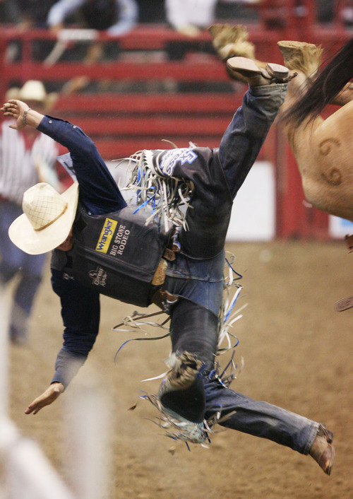 Steve Griffin | The Salt Lake Tribune   Jesse Wright, of Milford, Utah, flies off his horse during the saddle bronc riding event at the Days of '47 Rodeo at EnergySolutions Arena in Salt Lake City, Utah Tuesday July 23, 2013.
