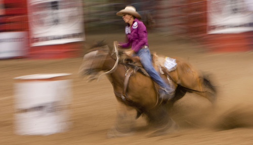 Steve Griffin | The Salt Lake Tribune   Jody Sheffield, of Ogden, Utah, competes during the barrel racing event at the Days of '47 Rodeo at EnergySolutions Arena in Salt Lake City, Utah Tuesday July 23, 2013.