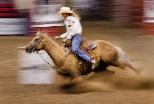 Steve Griffin | The Salt Lake Tribune   Sherry Cervi, of Marana, AZ,  races to first place in  the barrel racing event at the Days of '47 Rodeo at EnergySolutions Arena in Salt Lake City, Utah Tuesday July 23, 2013.