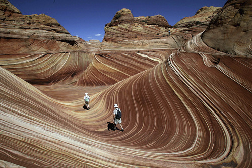 Tribune file photo Hikers among the rock formations at The Wave in the Coyote Buttes area of the Paria Canyon-Vermillion Cliffs Wilderness on the Utah/Arizona border in September 2007.