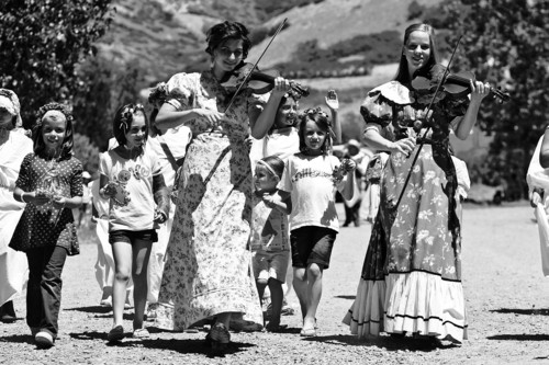 Chris Detrick | The Salt Lake Tribune  Violinists Phoebe Romney and Mary-Martha Jackson participate in the Village Parade walk during the 2011 Pioneer Days Festival at This Is the Place Heritage Park.