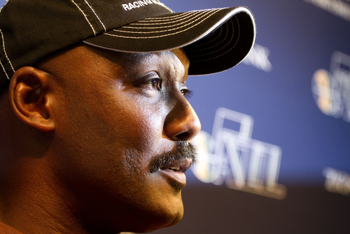Former Utah Jazz player Karl Malone talks to the media about Jerry Sloan's departure before the first half of an NBA basketball game between the Phoenix Suns and the Utah Jazz on Monday, Feb. 11, 2011, in Salt Lake City. (AP Photo/Jim Urquhart)