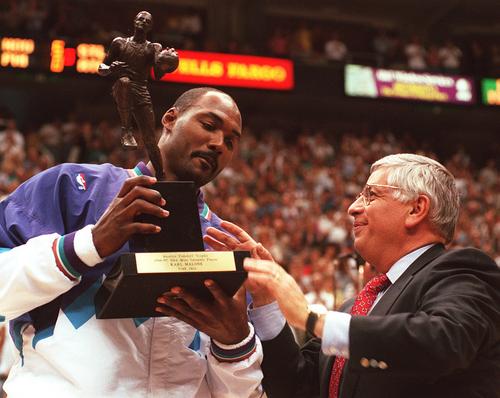 Tribune file photo  NBA commissioner David Stern presents Karl Malone the MVP trophy for the 1996-97 season.