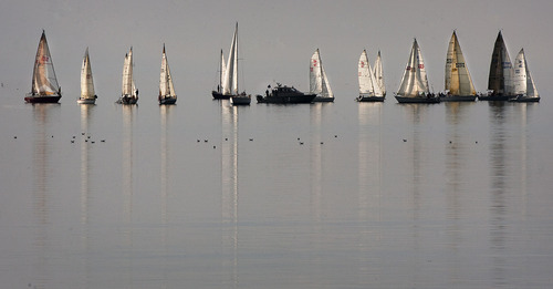 Steve Griffin | The Salt Lake Tribune   Members of the Great Salt Lake Yacht Club get into position for he start of the Wednesday night Regatta at the Great Salt Lake Wednesday July 17, 2013.
