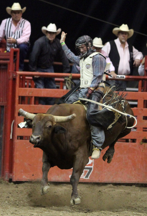 Rick Egan  | The Salt Lake Tribune   Josh Koshel, Nunn, Colo., competes in the Bull Riding competition, in the Days of '47 Rodeo at EnergySolutions Arena, Wednesday, July 24, 2013.