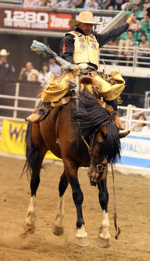 Rick Egan  | The Salt Lake Tribune   Dustin Flundra, Pincher Creek, Alberta, competes in the Saddle brocRiding competition, in the Days of '47 Rodeo at EnergySolutions Arena, Wednesday, July 24, 2013.