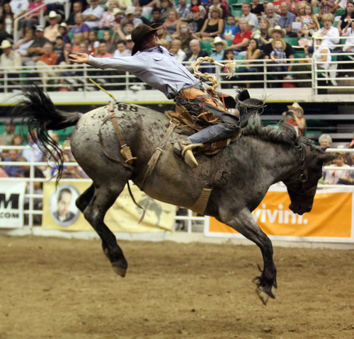 Rick Egan  | The Salt Lake Tribune   Ad Bugenig, Ferndale, Calif., competes in the Saddle Bronc Riding competition, in the Days of '47 Rodeo at EnergySolutions Arena, Wednesday, July 24, 2013.