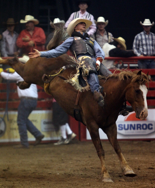 Rick Egan  | The Salt Lake Tribune   Clint Laye, Cadogan, Alberta, competes in the Bareback Riding competition, in the Days of '47 Rodeo at EnergySolutions Arena, Wednesday, July 24, 2013.
