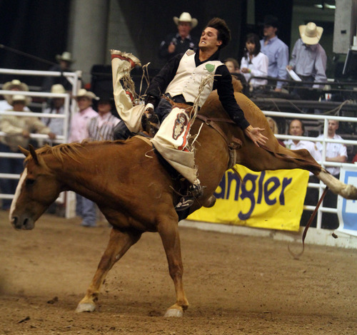 Rick Egan  | The Salt Lake Tribune   Caleb Bennett, Morgan, competes in the Bareback Riding competition, in the Days of '47 Rodeo at EnergySolutions Arena, Wednesday, July 24, 2013.