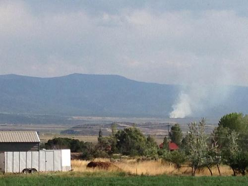 Courtesy Rep. Spencer Cox, R-Fairview.  In this photo from July 21, 2013, the Aspen Springs Frie sent smoke into the air east of Spring City, which is about two miles south of Mount Pleasant.