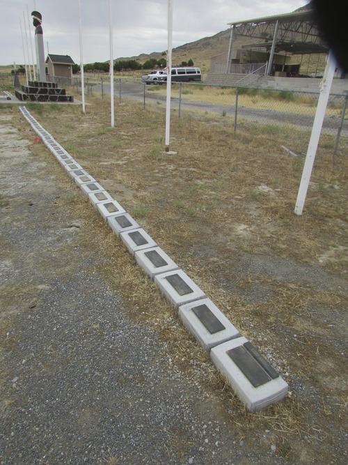 Long row of markers near Iosepa cemetery memorial. (Tom Wharton photo)
