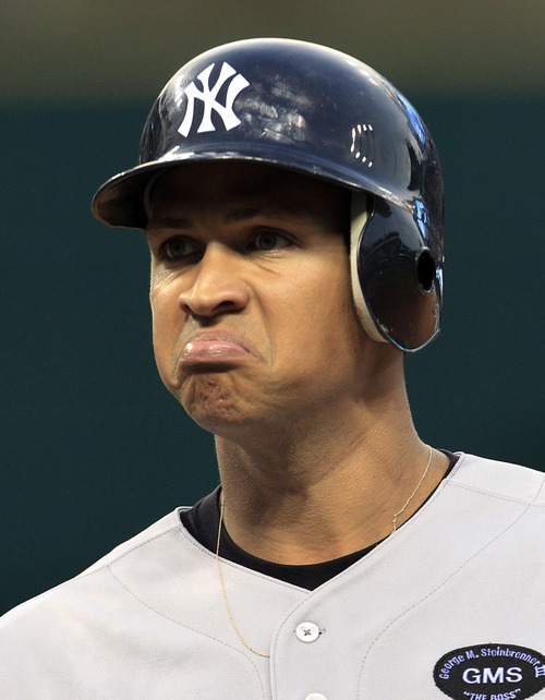 FILE - In this July 28, 2010 file photo, New York Yankees' Alex Rodriguez reacts after he popped out in the second inning in a baseball game against the Cleveland Indians in Cleveland. Injuries have kept him off the field for more than half the season and now A-Rod faces discipline from Major League Baseball in its drug investigation, possibly up to a lifetime ban.  (AP Photo/Tony Dejak File)