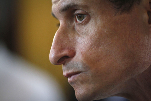 "Anthony Weiner, New York mayoral candidate, listens during a news conference, Thursday, July 25, 2013, in New York. Weiner introduced his proposal for a ""non profit czar"" should he become mayor, but a new poll suggests his new sexting scandal is taking a toll on his mayoral prospects.  (AP Photo/Bebeto Matthews)"