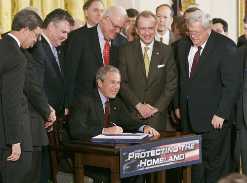 President Bush surrounded by members of Congress takes part in a signing ceremony for the USA Patriot and Terrorism Prevention Reauthorization Act, Thursday, March 9, 2006, in the East Room at the White House in Washington. After a long battle with Congress that went down to the wire Bush signed a renewal of the USA Patriot Act, a day before 16 major provisions of the old law expire.      (AP Photo/Ron Edmonds)