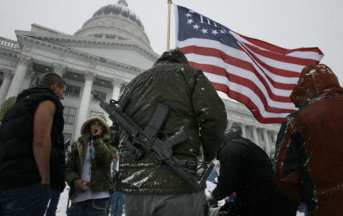 """Scott Sommerdorf      The Salt Lake Tribune Gun-rights activists rally at the Utah State Capitol as part of the """"National Day of Resistance"""" Saturday, Feb. 23, 2013. Utah will revoke the concealed weapons permit of anyone who has a medical marijuana license."""