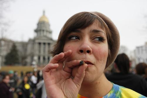 Jenny smokes a marijuana cigarette at a medical marijuana rally at Lincoln Park across from the Capitol  in Denver, on Thursday, Jan. 14, 2010. (AP Photo/Ed Andrieski)