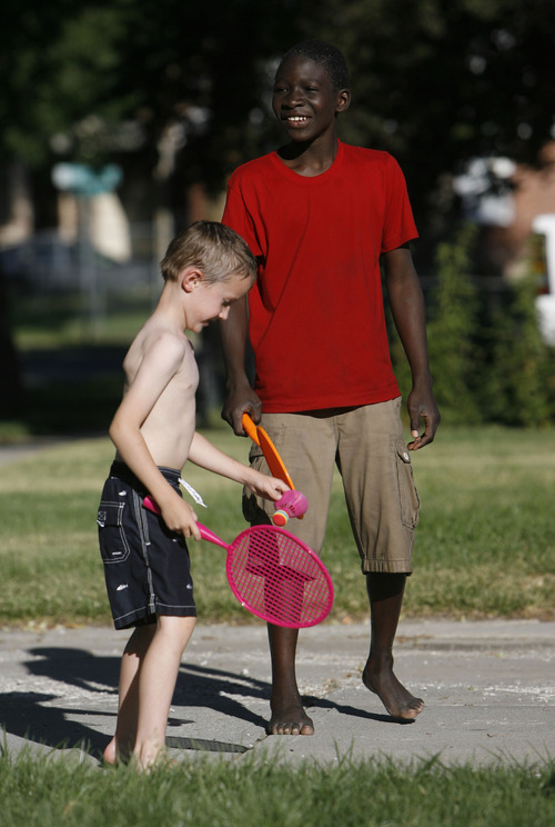 Francisco Kjolseth  |  The Salt Lake Tribune Brennon Auger, 5, and Juste Diandje, 13, play a game of badminton as Rose Park neighbors come together for a neighborhood barbecue along Lafayette Drive recently to enjoy each other's company.