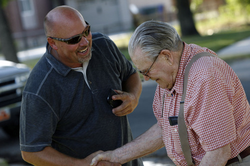 Francisco Kjolseth  |  The Salt Lake Tribune Brad Auger, left, of North Salt Lake, who was brought up in Rose Park, gives a big hello to George Jackson who has lived in the same house since 1951 as the two catch up during a neighborhood party in Rose Park recently.