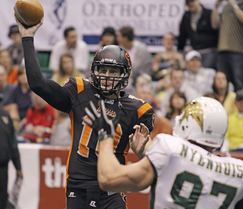 Lennie Mahler  |  The Salt Lake Tribune Utah Blaze quarterback Tommy Grady fires a pass in the first half against the San Jose SaberCats at EnergySolutions Arena on Saturday, March 24, 2012.