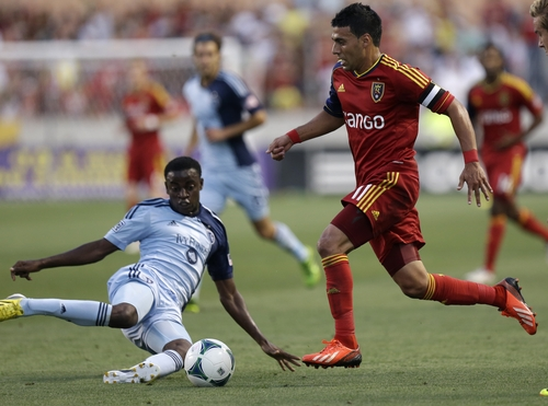 Sporting Kansas City's Peterson Joseph, left, defends against Real Salt Lake's Javier Morales, right, in the first half of an MLS soccer game on Saturday, July 20, 2013, in Sandy, Utah. (AP Photo/Rick Bowmer)