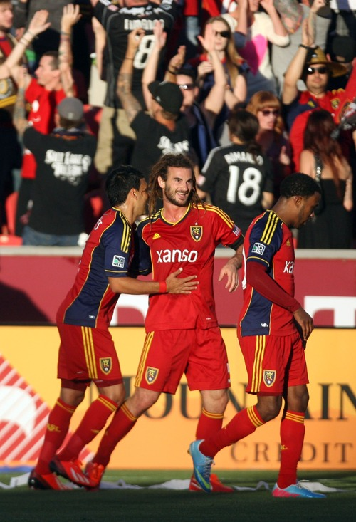 Kim Raff  |  The Salt Lake Tribune (middle) Real Salt Lake midfielder Kyle Beckerman (5) celebrates scoring the first goal of the game with teammates (left) Real Salt Lake midfielder Javier Morales (11) and (right) Real Salt Lake forward Robbie Findley (10) putting RSL ahead at the half during a game at Rio Tinto Stadium in Sandy on June 22, 2013.