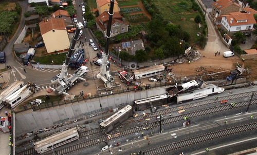 This aerial image taken from video shows a general view of the site of a train accident in Santiago de Compostela, Spain, on Thursday July 25, 2013. The death toll in a passenger train crash in northwestern Spain rose to 77 on Thursday after the train jumped the tracks on a curvy stretch just before arriving in the northwestern shrine city of Santiago de Compostela, a judicial official said. (AP Photo)