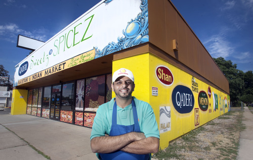 Steve Griffin | The Salt Lake Tribune   Asif Khanani stands outside his new store Qaderi Sweetz N. Spicez in Salt Lake City, Utah Tuesday July 23, 2013.  It is Khanani's second store in the valley. The first location, in West Valley City, has been open for 20 years. The store offers Indian and Southeast Asian foods.