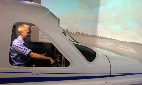Rick Egan  | The Salt Lake Tribune   Flight Instructor Mike Manning (left) gives instructions to student Tyler Gaebe (right) while sitting in a flight simulator at Westminster College, Thursday, July 25, 2013.
