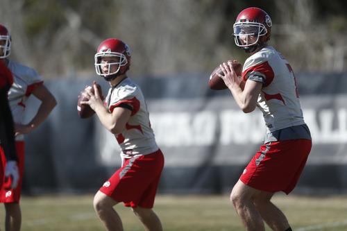 Chris Detrick     The Salt Lake Tribune Utah quarterback Travis Wilson and Adam Schulz throw the ball during spring practice Tuesday March 19, 2013.