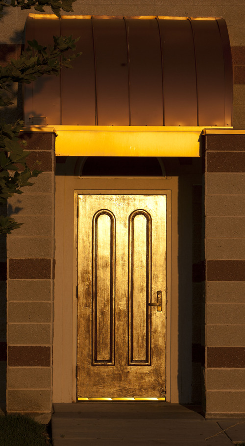 Steve Griffin | The Salt Lake Tribune  A copper awning and metallic door glow in the evening sun at the Khadeeja Islamic Center in West Valley City Sunday July 21, 2013.
