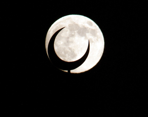 Steve Griffin   The Salt Lake Tribune  The full moon rises behind a crescent moon spire rising from the  minaret at the Khadeeja Islamic Center in West Valley City Sunday July 21, 2013.