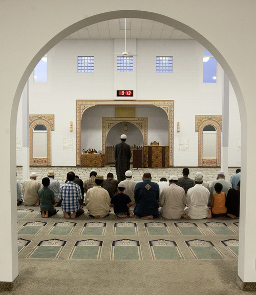 Steve Griffin   The Salt Lake Tribune  Muslims gather in the prayer hall at the Khadeeja Islamic Center following the breaking of the Ramadan Fast in West Valley City Sunday July 21, 2013.