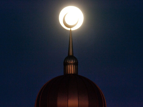 Steve Griffin | The Salt Lake Tribune  The full moon rises behind a crescent moon spire rising from the  minaret at the Khadeeja Islamic Center in West Valley City Sunday July 21, 2013.