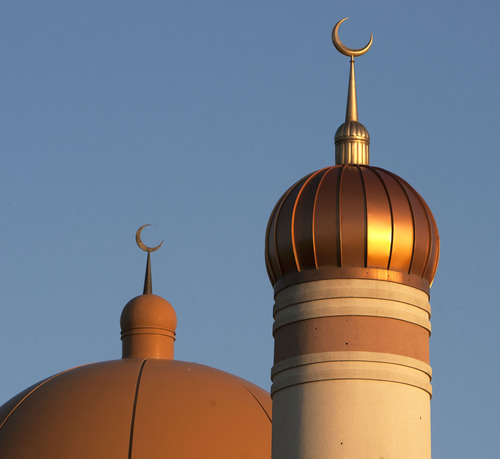 Steve Griffin | The Salt Lake Tribune  Crescent moon spires rise from the minaret, right, and dome at the Khadeeja Islamic Center in West Valley City Sunday July 21, 2013.
