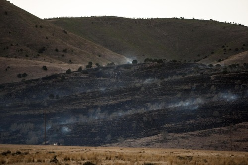 Chris Detrick  |  Tribune file photo The AR Fire burned about 1,600 acres on the west shore of Utah Lake in May and June of 2012. Investigators determined it was started by target shooting.