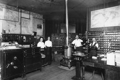 Photo Courtesy Utah State Historical Society  Post office employees inside of the Park City, Utah post office in 1900.