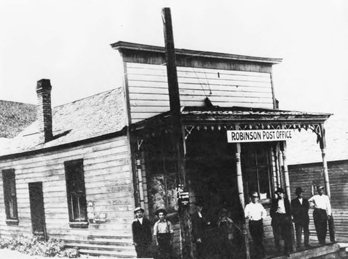 Photo Courtesy Utah State Historical Society  Men stand on the porch of the Robinson (middle Mammoth) post office.