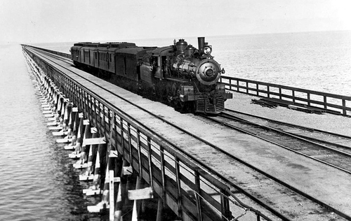 Photo Courtesy Utah State Historical Society  Southern Pacific mail train crossing Great Salt Lake on Lucin cut-off, about 1906. Gift of Arthur Petersen.