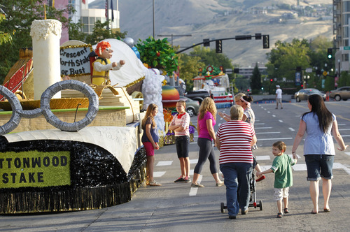 Al Hartmann  |  The Salt Lake Tribune Parade spectators and get a peek at floats lined up along West Temple for the July 24 parade festivities at 7:30 a.m.