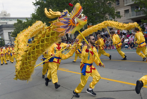 Al Hartmann  |  The Salt Lake Tribune Members of the Chinese Society of Utah run intricate patterns with a  dragon in the Days of '47 Parade in downtown Salt Lake City Wednesday July 24.